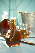 Maple syrup in bottles and small jug