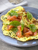 Herb omelette with smoked salmon and spinach