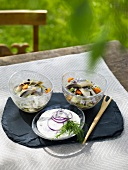 Two herring salads with yoghurt sauce