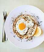 Flatbread topped with fried egg and baked goat's cheese