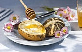 A poppy seed roll with honey