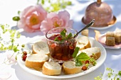 Wild strawberry jam in glass with baguette slices