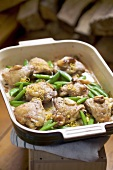Braised chicken pieces with snap peas