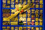 A blue seeding tray with various types of pasta