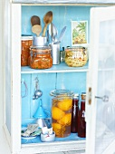 Preserved fruit and vegetables in a cupboard