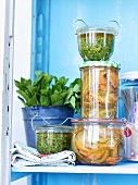 Mint and cashew pesto and pickled vegetables in preserving jars