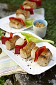 Grilled sausage kebabs with pepper and onion