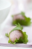 Mochi (Japanese rice cakes) filled with bean paste and wrapped in perilla leaves