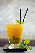Passion Mojito (cocktail made with rum, passion fruit liqueur, passion fruit puree, lime juice, sugar syrup and mint)