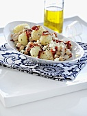 Potato and bean salad with pancetta, dried tomatoes and feta