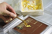 Decorating chocolate with gold leaf