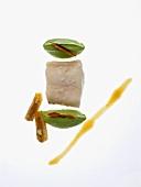 Cod poached in coffee cream with guacamole and chorizo