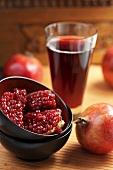 A pomegranate, pomegranate seeds and pomegranate juice