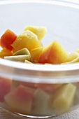 Fresh fruit salad in a plastic bowl