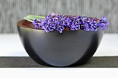 Springs of lavender with flowers on a bowl