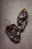 Two dried Poblano chili peppers