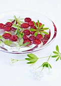 Raspberries in syrup with woodruff