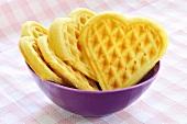 Heart-shaped waffles in a purple bowl