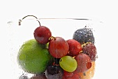 Various types of fruit in a misted glass