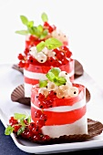 A layered dessert with redcurrent jelly and cream