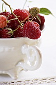Fresh raspberries in a porcelain cup (close up)