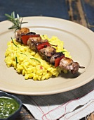 Rabbit and vegetable kebab on a bed of risotto