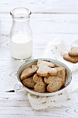 Heart-shaped nut biscuits and a bottle of milk