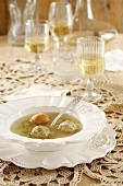 Clear broth with matzo dumplings