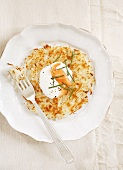 Rösti (fried Swiss potato cake) with sour cream and smoked salmon