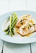 Poached salmon fillet with green asparagus