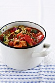 A pot of tomato and courgette soup