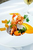 Prawns with sauce and fruit