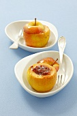 Two baked apples with rose preserve