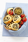 Yeast dough pastries with black and green olives