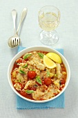 Fish stew with couscous with tomatoes