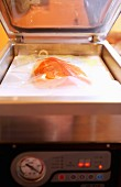 Salmon fillet in a vacuum press