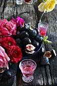Fresh figs, rose tea and roses