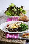 Stuffed aubergines topped with melted cheese