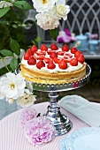 Strawberry cake on cake stand