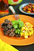 Beef with a chill and mango salsa and corriander