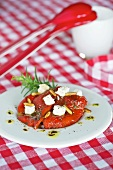 Roasted peppers with feta and pine nuts