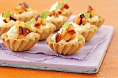 Tartlets with whipped cream and plums