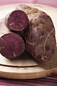 Purple yams, whole and halved