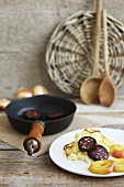 Black pudding with apples, mashed potatoes and onions