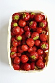 Strawberries in a wooden basket, seen from above