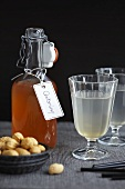 Quince syrup in a bottle and in glasses