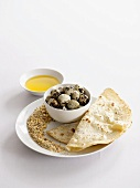 Quails eggs with dukkah and flat bread (Egypt)