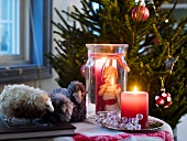Christmas decoration with candles and fabric lambs