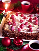 A Christmas cake with raspberries