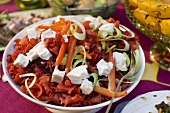 Salad with red pasta, carrots, leek and cream cheese